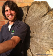 chris eastaff the tree surgeon by a tree trunk